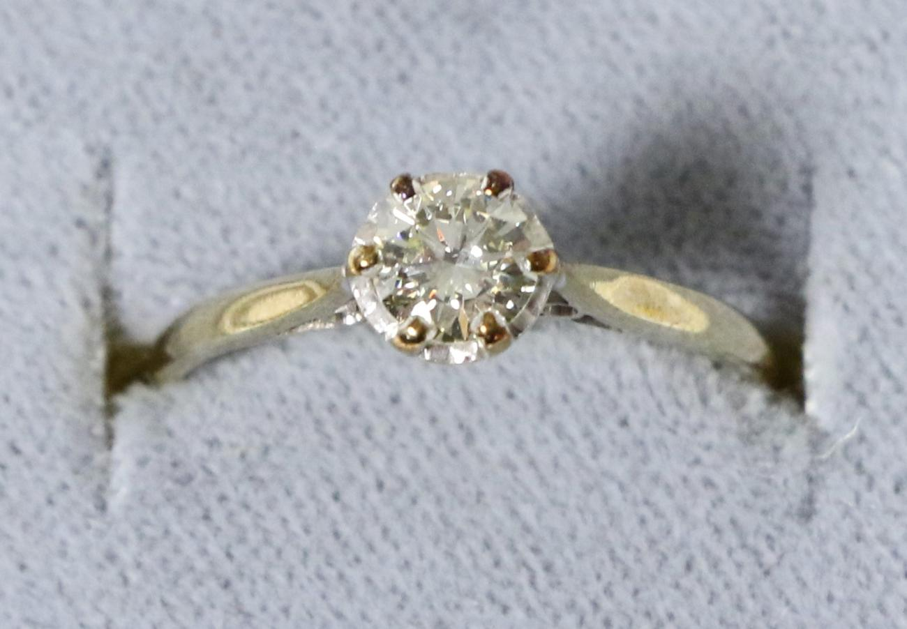 Lot 30 - A solitaire diamond ring, a round brilliant cut diamond in a claw setting, to an extended under...