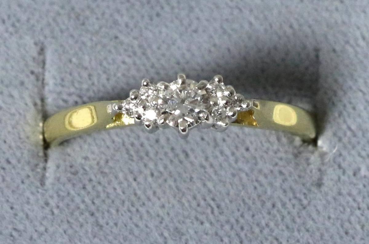 Lot 32 - An 18 carat gold diamond ring, a round brilliant cut diamond to diamond set shoulders, total...