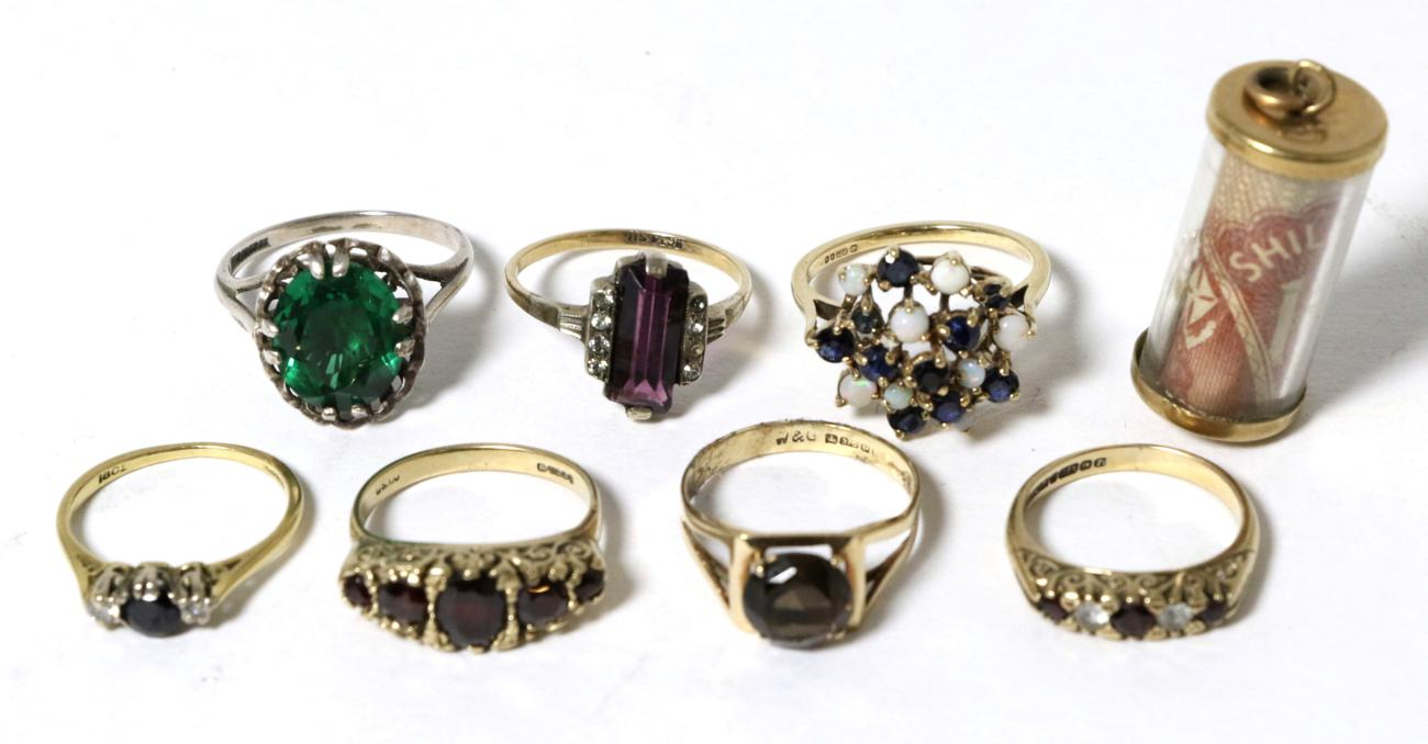 Lot 45 - A 9 carat gold opal and sapphire cluster ring, finger size O; a 9 carat gold smokey quartz...