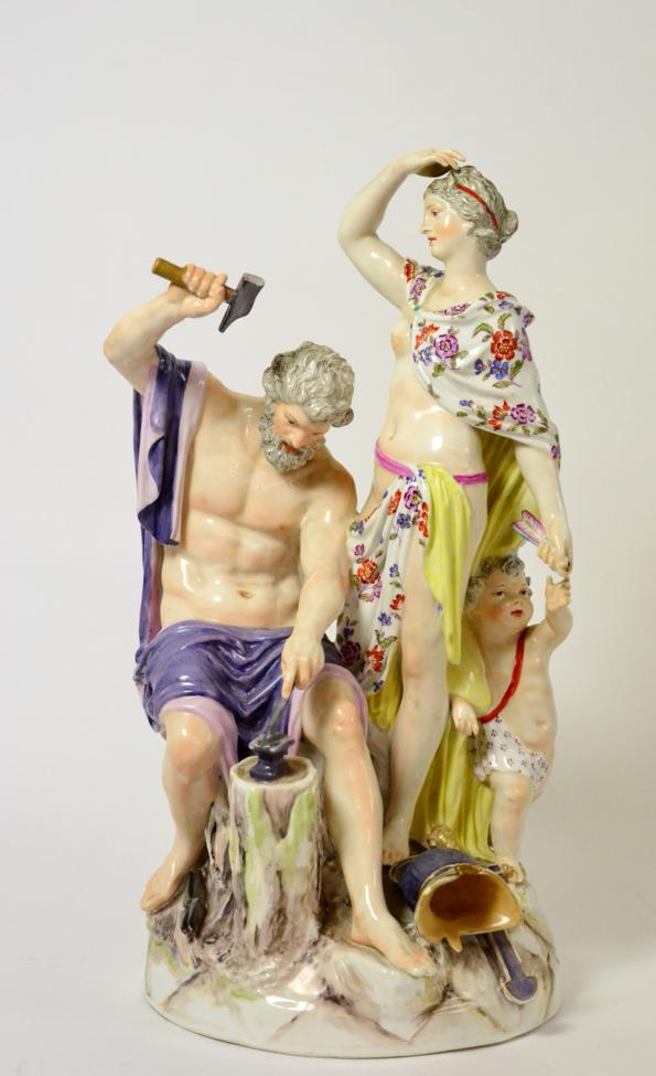 Lot 26 - A Berlin Porcelain Figure Group, late 19th century, as Vulcan sitting at an anvil, Venus and...