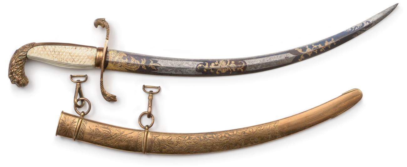 Lot 29 - An Early 19th Century Naval Dirk, the 23.5cm single edge curved blued steel blade engraved and gilt