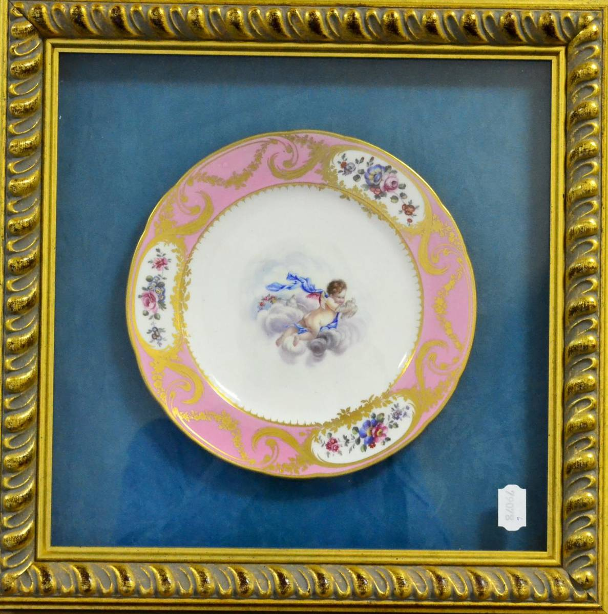 Lot 30 - A Sèvres Style Porcelain Plate, in 18th century style, painted with a cherub amongst clouds...