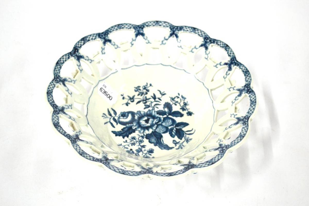 Lot 5 - A First Period Worcester Porcelain Circular Basket, circa 1775, printed in underglaze blue with the
