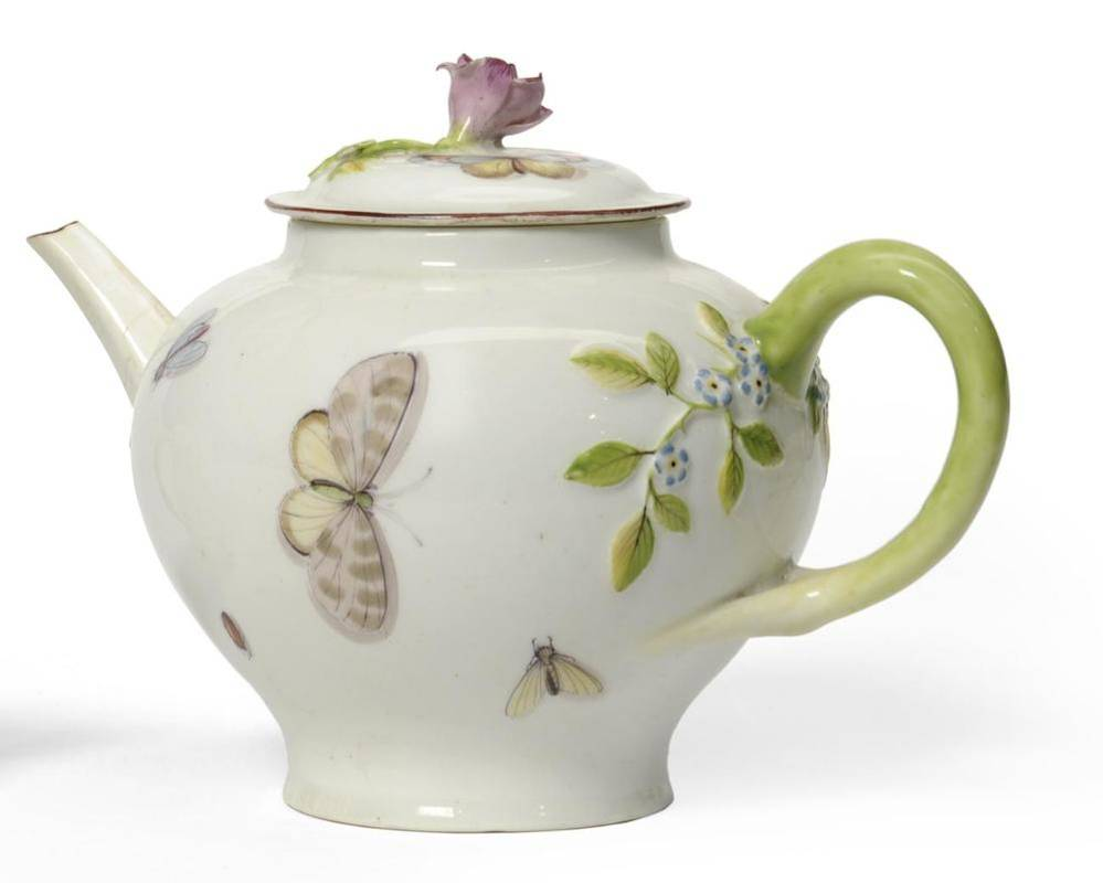 Lot 11 - A Chelsea Porcelain Teapot and Cover, circa 1755, of baluster form painted with insects, within...