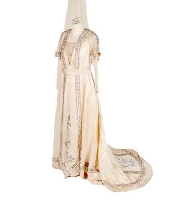 Lot 2071 - Early 20th Century Cream Silk Wedding Dress,...