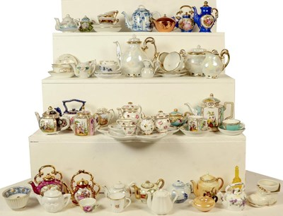 Lot 77 - A quantity of miniature china teapots and...