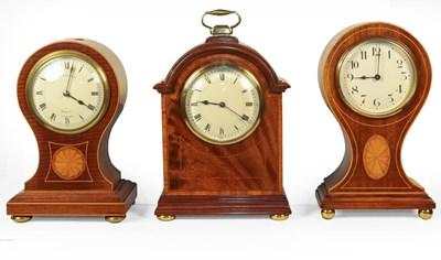Lot 86 - Three Edwardian inlaid mahogany mantle...