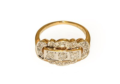 Lot 87 - A diamond three stone ring within an openwork...