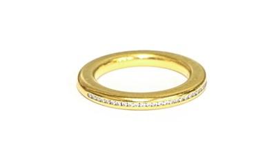 Lot 93 - An 18 carat gold diamond half hoop ring,...