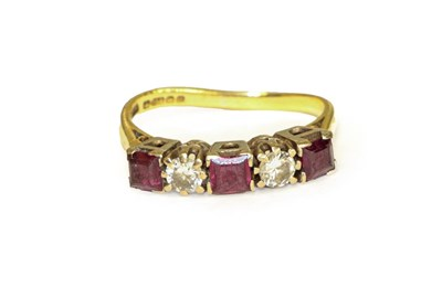 Lot 97 - An 18 carat gold ruby and diamond five stone...