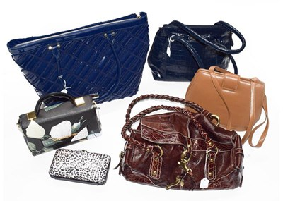 Lot 1001 - A Ted Baker floral handbag, an Osprey navy...