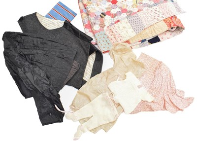 Lot 1037 - A late 19th century patchwork quilt with...