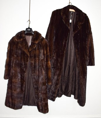 Lot 1049 - A long dark mink coat, together with another...