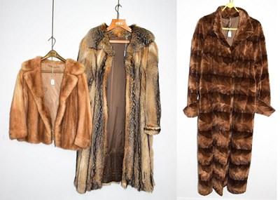 Lot 1051 - A brown textured full length fur coat, a Jean...