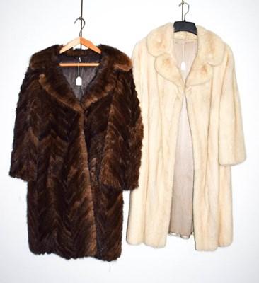 Lot 1053 - A white mink three quarter length coat, and a...