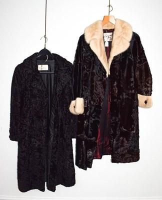 Lot 1054 - A Continental fur Blackpool black hide coat...
