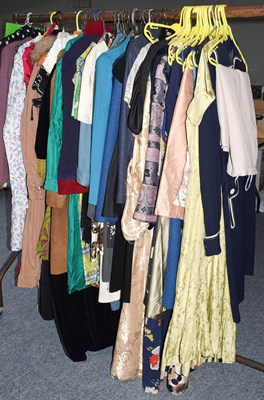 Lot 1056 - An assortment of clothing, to include: ladies...
