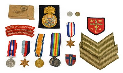 Lot 12 - A Second World War Group of Three Medals,...