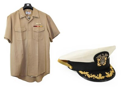 Lot 69 - A US Navy Shirt and Peaked Cap, the shirt in...