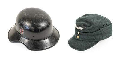 Lot 73 - A German Third Reich Luftshutz Helmet, painted...