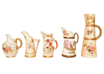 Lot 16 - Five Royal Worcester blush ware ewers painted...