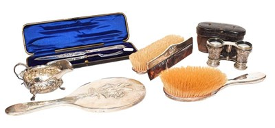Lot 27 - A silver mounted four-piece vanity set by...