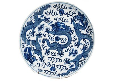 Lot 30 - A 19th century Chinese blue and white dish,...