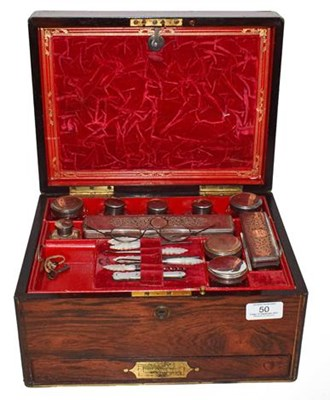 Lot 50 - A Victorian rosewood fitted travelling vanity...