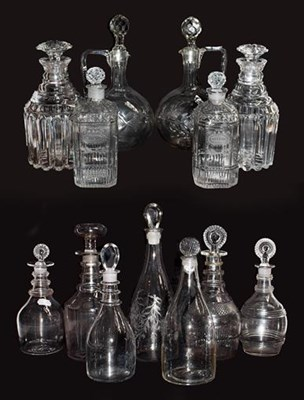 Lot 56 - A pair of cut glass decanters engraved...