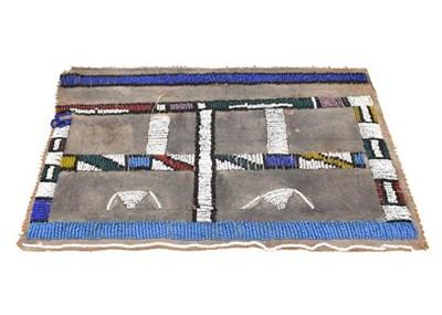 Lot 67 - A Zulu Modesty beaded apron on a canvas backing