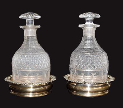 Lot 73 - A pair of Old Sheffield plate decanter stands...