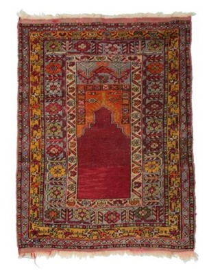 Lot 531 - Anatolian Prayer Rug, circa 1900 The crimson...