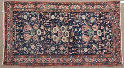 Lot 564 - Kurdish Rug West Iran, circa 1920 The indigo...