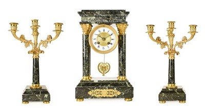 Lot 567 - A Green Marble Portico Striking Mantel Clock...
