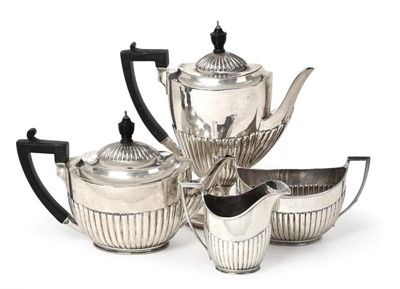 Lot 2040 - A Four-Piece Victorian Silver Tea and...