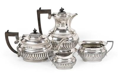 Lot 2074 - A Four-Piece Edward VII Silver Tea-Service,...