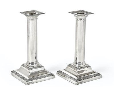 Lot 2077 - Two George V Silver Candlesticks, One by...