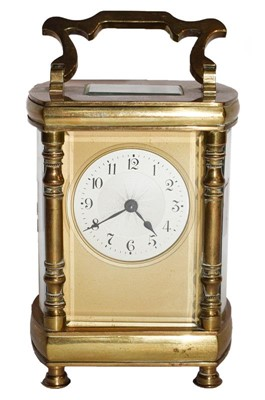 Lot 59 - Brass cased bow sided carriage timepiece,...
