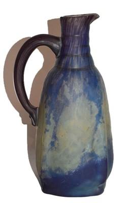 Lot 54 - A Daum Nancy glass jug, mottled purple and...