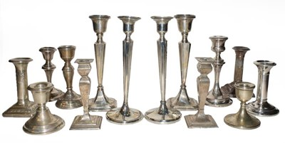 Lot 90 - A collection of assorted silver candlesticks,...