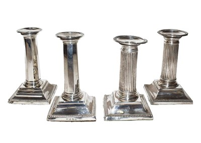 Lot 95 - Two Pairs of Edward VII Silver Candlesticks,...