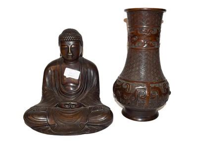Lot 36 - A Chinese bronze statue of a seated Buddha,...