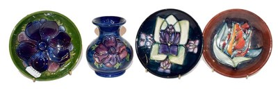 Lot 40 - Two Moorcroft pin dishes, a small dish and a...