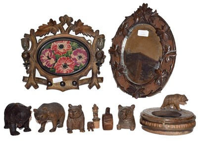 Lot 10 - A group of carved wooden articles including...