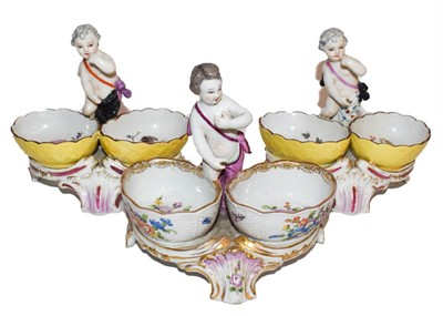 Lot 65 - A pair of continental porcelain salts and...