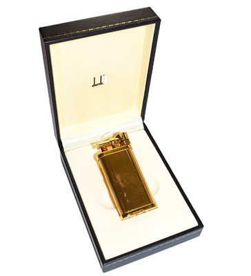 Lot 89 - A Dunhill gold plated lighter with engine...