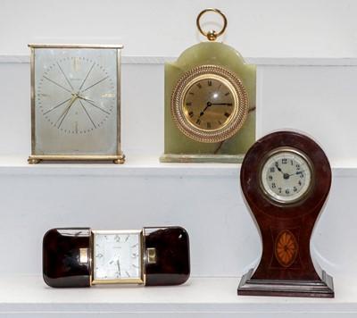 Lot 17 - A brass cased mantel timepiece signed Garrard,...