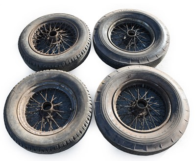 """Lot 64 - A Set of Four 16"""" Wire Wheels, with rubber..."""