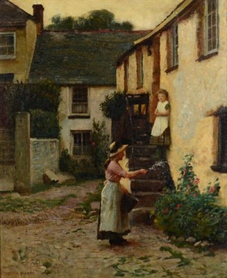Lot 26 - Trevor Haddon (1864-1941) Lady tending a bed of flowers outside a cottage  Signed, oil on...