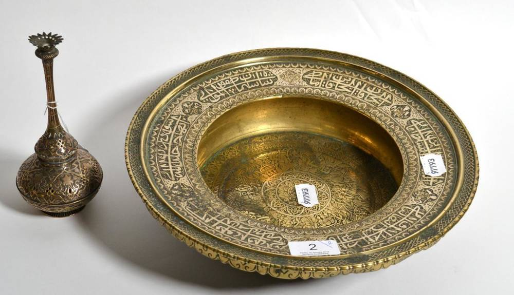 Lot 2 - A Persian brass dish, late 19th century, figural design; with another (2)